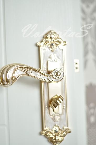 Дверная ручка в стиле барокко