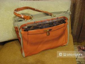 Эффектная сумка бренда  Pomikaki