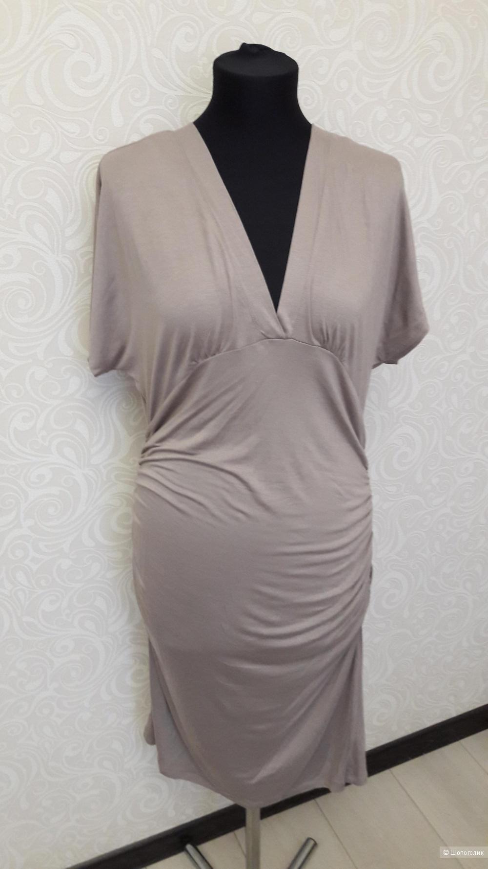 Стильное платье марки POMPA..L