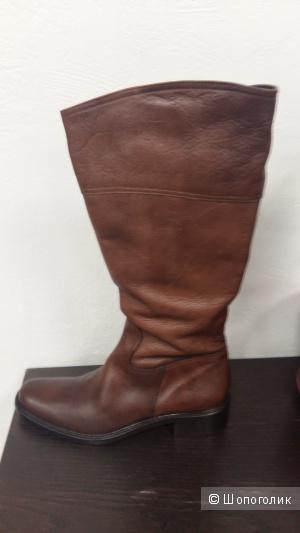 Продаю новые в коробке кожаные коричневые сапоги 40размер на 41 размер»