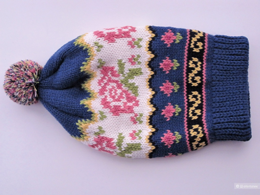 Очень теплая вязаня шапка
