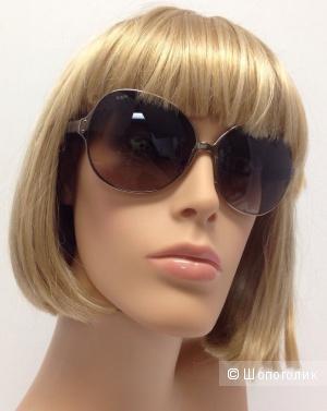 Женские солнцезащитные очки Tod's