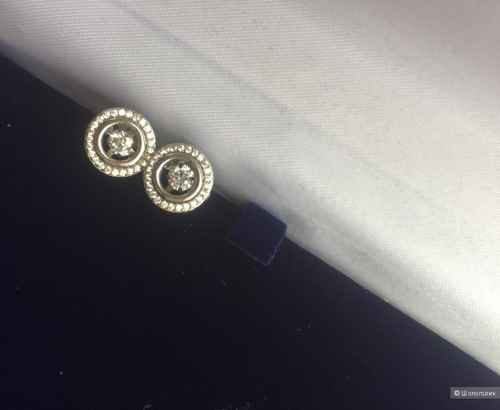 Серебряные серьги- гвоздики с танцующим камнем Sandara Ice 925 пробы