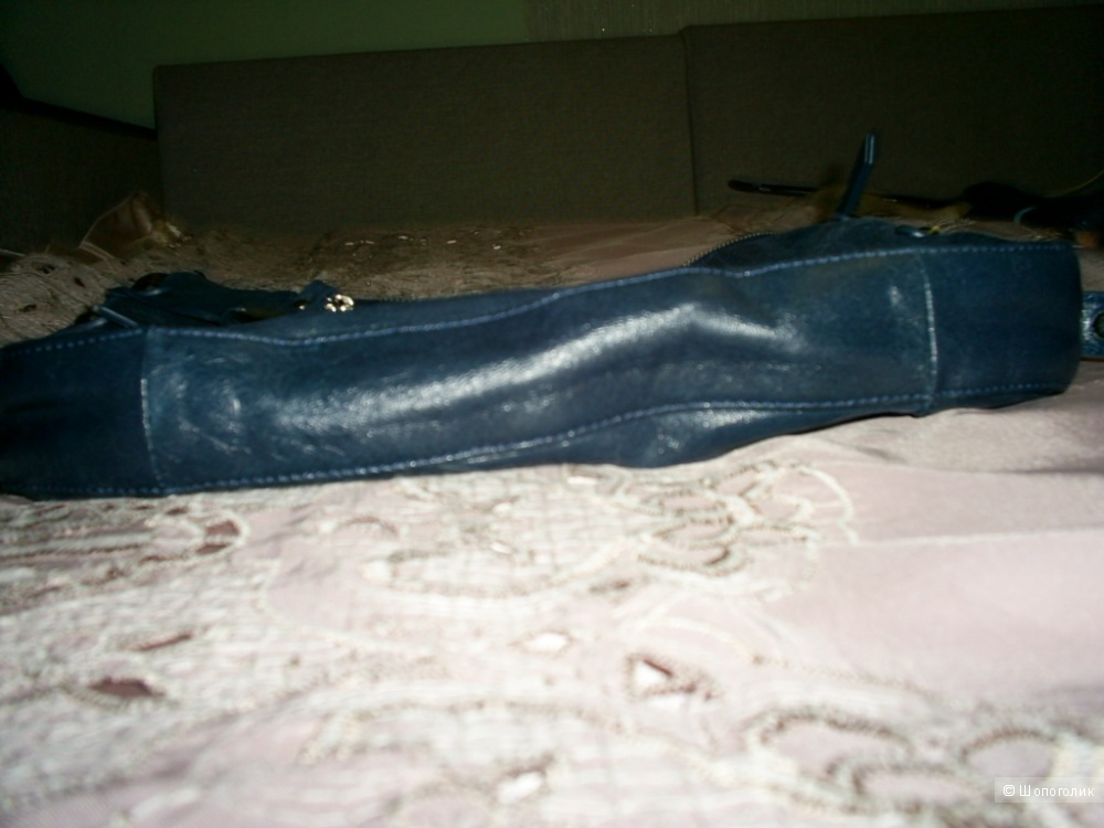 Кожаная сумка от Tula.