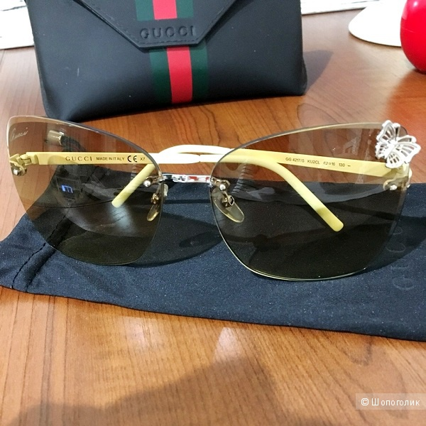 Солнцезащитные очки Gucci.