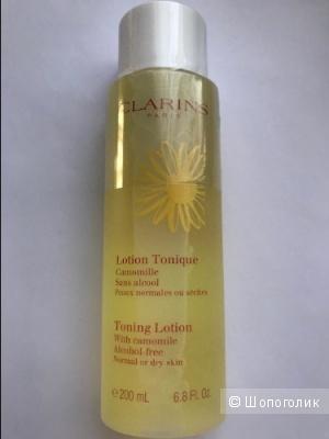 Clarins Тонизирующий лосьон для сухой или нормальной кожи с экстрактом Ромашки  200 мл